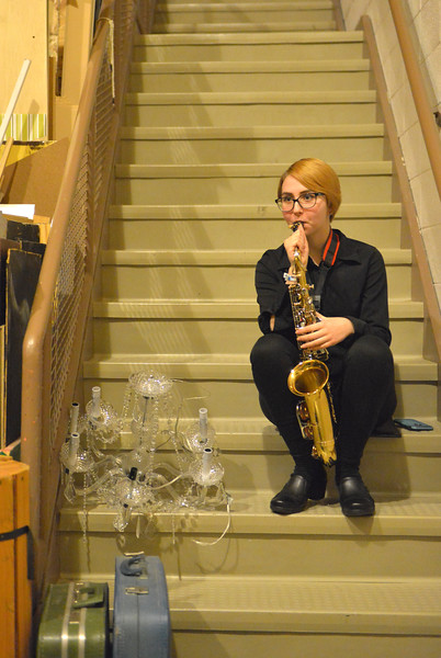Justin Sheely | The Sheridan Press<br /> Music student Bailey Hanson blows air into her alto sax to keep it warm and in tune backstage during the Sheridan High School band department's winter concert at the Sue Henry auditorium at Sheridan High School Tuesday, Dec. 19, 2017.