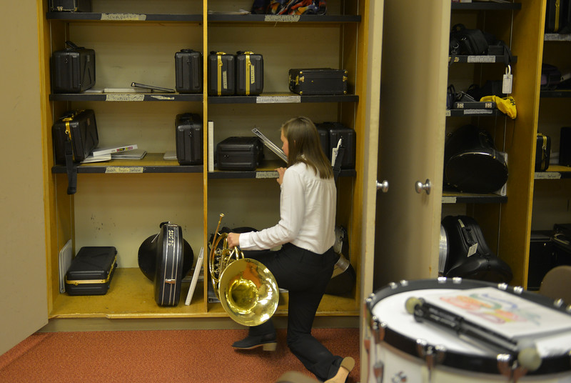 Justin Sheely | The Sheridan Press<br /> A music student pulls her instrument out of storage before the Sheridan High School band department's winter concert at the Sue Henry auditorium at Sheridan High School Tuesday, Dec. 19, 2017.