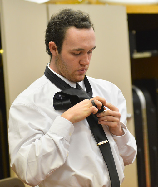 Justin Sheely | The Sheridan Press<br /> Race Johnson ties a neck tie for a fellow student in preparation for the Sheridan High School band department's winter concert at the Sue Henry auditorium at Sheridan High School Tuesday, Dec. 19, 2017.