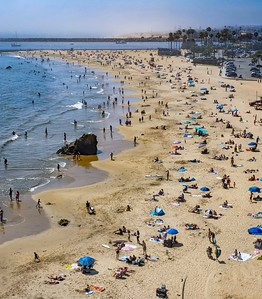 Thousands flocked to the beach to avoid sweltering heat inland. Most were socially distanced appropriately