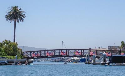Flags adorn the bridge to Lido Island