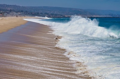 Meanwhile, now empty beaches were pounded by the relentless surf