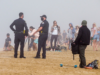 Beach clearing by reluctant officers occurred at 9am