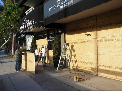 Shops in Corona del Mar covered windows to protect their businesses.