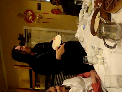 Ge explaining how to eat Peking Duck
