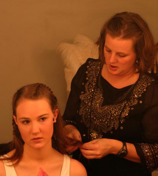 drama teacher Mollie McNally prepares junior Sarah Casey's hair in a dressing room for Aida.