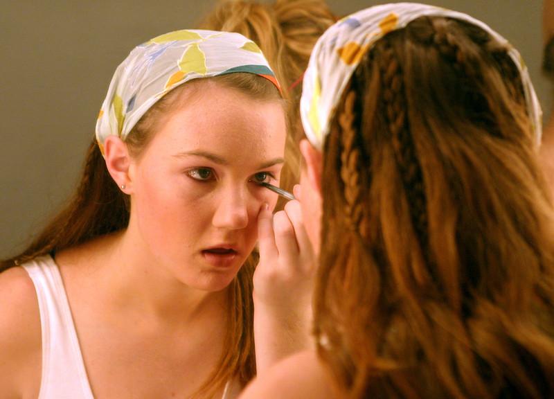 junior Sarah Casey applies eyeliner preparing for her role in Aida.