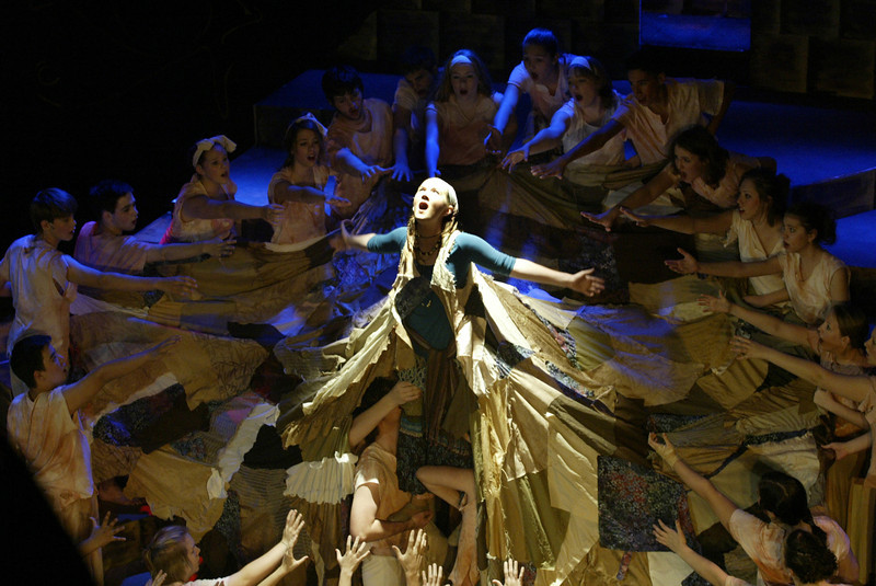 """As junior Sarah Casey, Aida, is lifted up, she sings the song 'Dancing Robe.' The robe costume was 13 feet in diameter, and was quilted together by the costume crew. The robe would sometimes choke her because it was tied around her neck. """"One of the harder parts in Aida was wearing the robe, since it was so long and bulkily,"""" Casey said."""