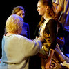 drama teacher Maureen Davis fixes junior Sarah Casey's costume during Aida rehearsal.