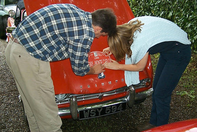 Roger and Jane making sure the sticker is well aligned.
