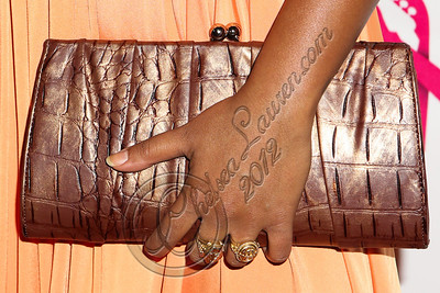 LOS ANGELES, CA - JUNE 29:  Recording artist Melanie Fiona (clutch detail) attends Steve Rifkind's Pre-BET Awards celebration honoring BET nominee Melanie Fiona at Nobu on June 29, 2012 in Los Angeles, California.  (Photo by Chelsea Lauren/WireImage)