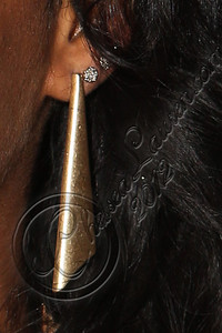 LOS ANGELES, CA - JUNE 29:  Recording artist Melanie Fiona (earring detail) attends Steve Rifkind's Pre-BET Awards celebration honoring BET nominee Melanie Fiona at Nobu on June 29, 2012 in Los Angeles, California.  (Photo by Chelsea Lauren/WireImage)