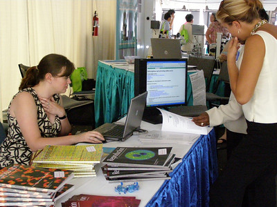 The Reproduction Journal booth. Lindsay Hook from Bristol, UK chats with a booth visitor during SSR 2008 in Kailua-Kona, Hawai'i (May)