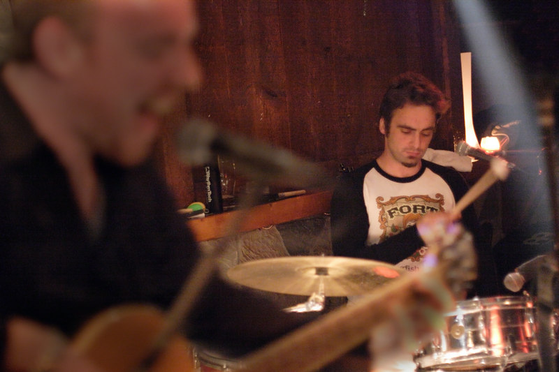 After a long hiatus while touring the Northeast U.S., Sunnyside-by-way-of-Dublin band Stand played an intimate acoustic set at Maggie Mae's on May 27, 2006.  The homecoming performance was Stand's first show on Queens Boulevard's strip of Irish public houses in over a year, when the band played its last regular shows at the storied Tailors Hall.  Photo © Shams Tarek (www.shamstarek.com)