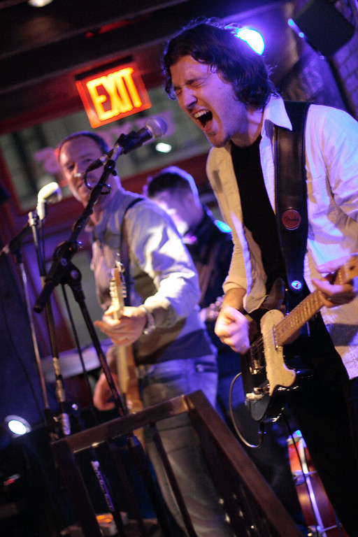 After a long absence from Manhattan while recording and touring the Northeast U.S., Sunnyside-by-way-of-Dublin band Stand played a powerful electric set at Ulysses, tucked away in the Financial District, on June 10, 2006.  The band played some of its new material, which is departing from straight rock and roll and is embracing more and more electronic sounds.  Photo © Shams Tarek (www.shamstarek.com)