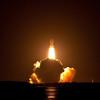 STS-131 Discovery rises from launch above the exhaust cloud. Taken from NASA causeway six miles from pad.