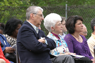 (L-r) Philip Jardina of Immaculate Heart of Mary Church, Atlanta, his wife Angela and his daughter Mary Jardina Morrison listen as John Berry, CEO and executive director of the Society of St. Vincent de Paul Atlanta, addresses the crowd. The food pantry inside the new West End Family Support Center is dedicated to the memory of Philip's deceased, older brother James. The Jardina brothers and their family attended St. Anthony Church in West End Atlanta as kids.