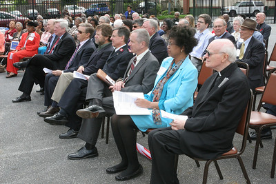 (Front row, r-l) Passionate Father Jerome McKenna, pastor of St. Paul of the Cross Church, Atlanta, Debbie Cook, past president of the St. Anthony St, Vincent de Paul Conference, Tom Andrews, president of St. Joseph Hospital Mercy Care Services, Major Jim Seiler, metropolitan Atlanta area commander for The Salvation Army, Bill Bolling, founder and executive director of the Atlanta Community Food Bank, Joseph Krygiel, CEO of Catholic Charities Atlanta, John Berry, CEO and executive director of the Society of St. Vincent de Paul Atlanta, and Dick Kessler, president and chairman of the board of the Society of St. Vincent de Paul Atlanta listen to remarks from Archbishop Gregory.