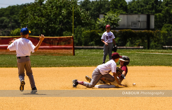 A member of the Major Garnet all-star team tries to steal second base.