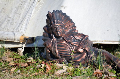 Indian in front of Teepee at Sacred Grove Retreat Center