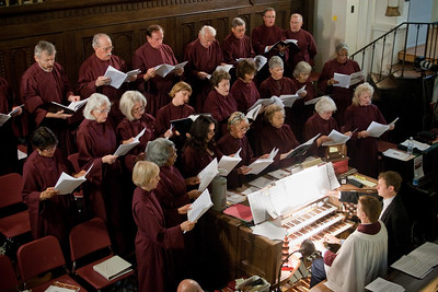 The Basilica principal choir and soloists perform before the Mass in the church's balcony.