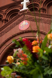 Pots of flowers adorn the entrance of Sacred Heart Basilica, Atlanta, where a new symbol was placed above its doors to mark the historic building's elevation to a minor basilica.  (Photo by Thomas Spink)  (Page 1, September 2, 2010 issue)