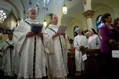 Former Sacred Heart pastor, Father Steven Yander (left) and Father Patrick Scully process in with other priests as women religious and members of the congregation look on.  (Photo by Thomas Spink)  (Page 2, September 2, 2010 issue)