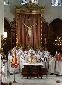 Book-ended between the newly installed Basilica symbols, Archbishop Wilton D. Gregory, center, and other clergy gather on the altar during the Aug. 21 Mass marking the elevation of Sacred Heart to a minor basilica. (Photo by Thomas Spink)  (Page 3, September 2, 2010 issue)