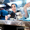 "P4303947<br /> Mandi Pisano of MiniBurger (Sacramento) explains the menu options to a customer.<br />  <a href=""http://www.miniburgertruck.com"">http://www.miniburgertruck.com</a>"