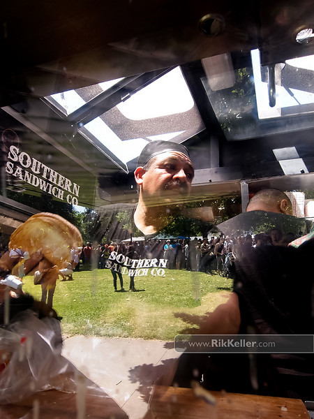 """P4303955<br /> ??? from The Southern Sandwich Company (San Franscisco) prepares an order. As seen in the reflection, the lines for the trucks stretched dozens of people deep.<br />  <a href=""""http://www.southernsandwich.com"""">http://www.southernsandwich.com</a>"""