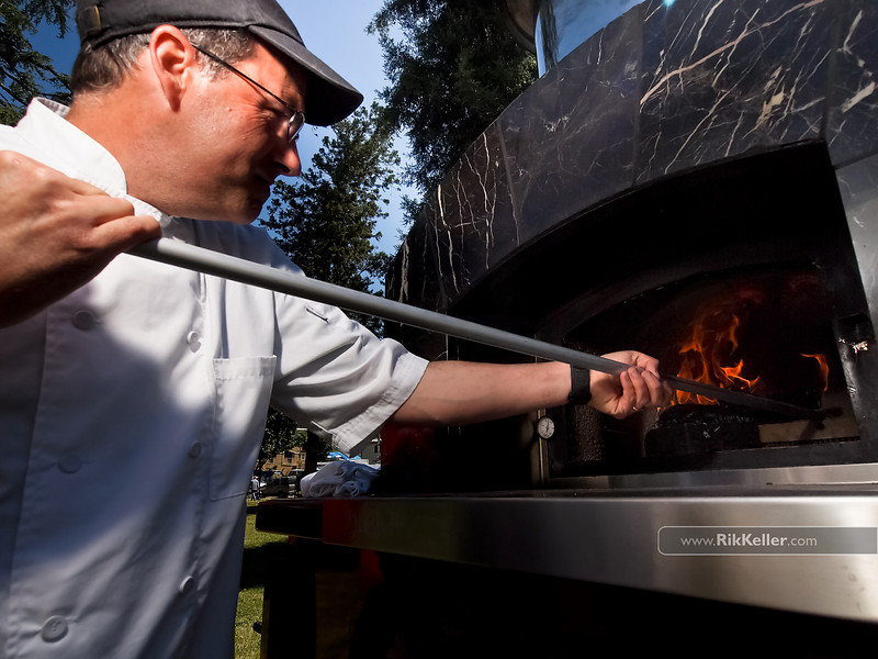 """P4303865<br /> Michael Johnson of The Pizza Company (Sacramento) retrieves a pizza from the almond woodfired oven.<br />  <a href=""""http://www.woodfiredpizzacompany.com"""">http://www.woodfiredpizzacompany.com</a>"""