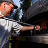 "P4303865<br /> Michael Johnson of The Pizza Company (Sacramento) retrieves a pizza from the almond woodfired oven.<br />  <a href=""http://www.woodfiredpizzacompany.com"">http://www.woodfiredpizzacompany.com</a>"