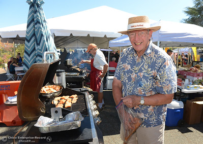 "Larry Jendro, president of the Oroville Optimist Club grills salmon as the club sells salmon meals and ""salmon dogs"" Saturday, Sept. 24, 2016, during the Salmon Festival in Oroville, California. (Dan Reidel -- Enterprise-Record)"