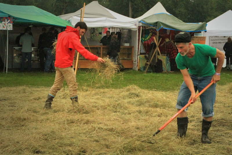 Laying out hay to soak up the mud.