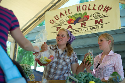 Lark selling Quail Hollow Farm CSA produce at the Summer Salsa Contest at Quail Hollow Farm CSA Moapa Valley community supported agriculture. Farm website www.quailhollowfarmcsa.com Photographs in this public online gallery free downloads for Quail Hollow Farm by Mark Bowers of ReallyVegasPhoto.com
