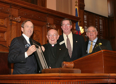 As he is honored by the House of Representatives on March 8, Msgr. R. Donald Kiernan, pastor emeritus at Dunwoody's All Saints Church, second from left, is joined by (r-l) State Senator Fran Millar of Atlanta's District 40, Rep. Tom Taylor of Dunwoody's District 79 and the Speaker of the House David Ralston. The State Senate also honored Msgr. Kiernan.
