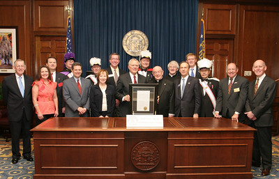 Gathering in the governor's office, Msgr. R. Donald Kiernan, pastor emeritus at Dunwoody's All Saints Church, front row, fifth from right, stands between Georgia Governor Nathan Deal, holding the resolution, and State Senator Fran Millar of Atlanta's District 40. On March 8 both chambers of the Georgia General Assembly honored Msgr. R. Donald Kiernan on the occasion of his retirement. Others on hand for the occasion included Rep. Tom Taylor of Dunwoody's District 79, Ken Wright, the mayor of Dunwoody, John Heneghan and Danny Ross of the Dunwoody City Council, current All Saints pastor Msgr. Hugh Marren, All Saints director of operations Joan McIvor, members of the Knights of Columbus' Council 11402 and members of All Saints Church.