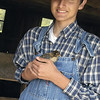 Record-Eagle/Lisa Perkins<br /> Jonny Courtade, an eighth-grade student from Cherryland Middle School, took time to hold a baby chick while he and his classmates shared information about the Samels Farm with fourth-grade students from Lakeland Elementary School.