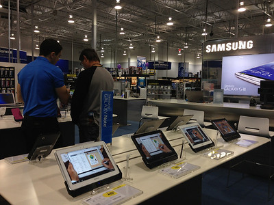 A customer checks out products at the Samsung Experience Shop inside a Best Buy in Lewisville, Texas. Samsung plans to open 1,400 of these store-within-a-store locations by June.