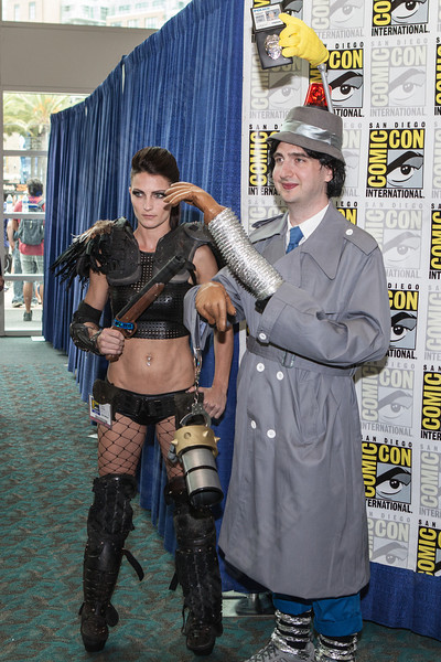 Inspector Gadget takes a photo with... girl with a gun...