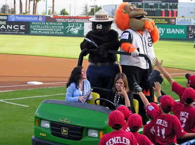 Team mascot and his pal, Smokey, drive by some fans.
