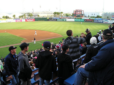 The crowd stands and applauds the home team's first (and only) homer of the evening.