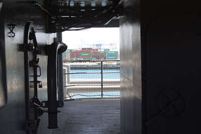 Looking across the USS Iowa bridge to a container yard.