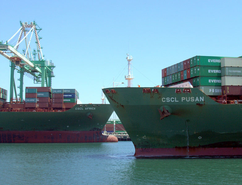 Two large container ships, same company. Note the difference in draft (distance in the water).