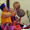 Lama Karma Namgyel, left, and othet Buddhists, perform during the dismantling ceremony on Sunday.<br /> Members of the  Longmont Buddhist Temple and Drukpa Mila Center dismantled the Buddha of Compassion Sand Mandala and dispersed it at Kanemoto Park in Longmont.<br /> Cliff Grassmick / September 20, 2009