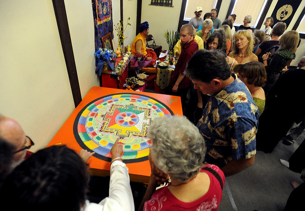 People line up to see the sand mandala before it is dismantled.<br /> Members of the  Longmont Buddhist Temple and Drukpa Mila Center dismantled the Buddha of Compassion Sand Mandala and dispersed it at Kanemoto Park in Longmont on Sunday.<br /> Cliff Grassmick / September 20, 2009