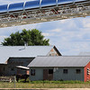Amish farm buildings and sand mine conveyer belt