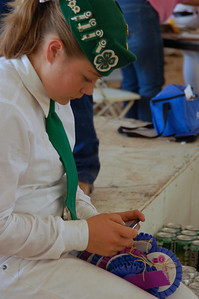 4H gal with ribbons and--well, she's a teen--text messaging.
