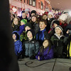 Record-Eagle/Jan-Michael Stump<br /> People watch Santa Claus arrive on stage in downtown Traverse City Friday evening to light the downtown Christmas tree.