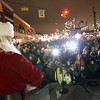 Record-Eagle/Jan-Michael Stump<br /> Santa Claus addresses the crowd after arriving in downtown Traverse City Friday evening to light the downtown Christmas tree.